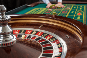 Casino roulette table with gambling chips